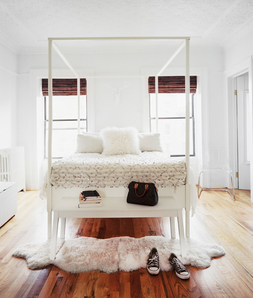 Lonny Bedroom+white+bench+pair+sheepskin+rugs+foot+omI_