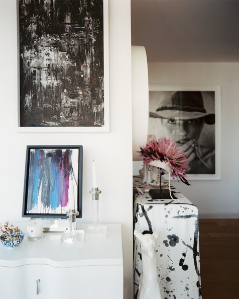 Lonny - Eclectic Hallway+Lucite+candlesticks+framed+art+white+