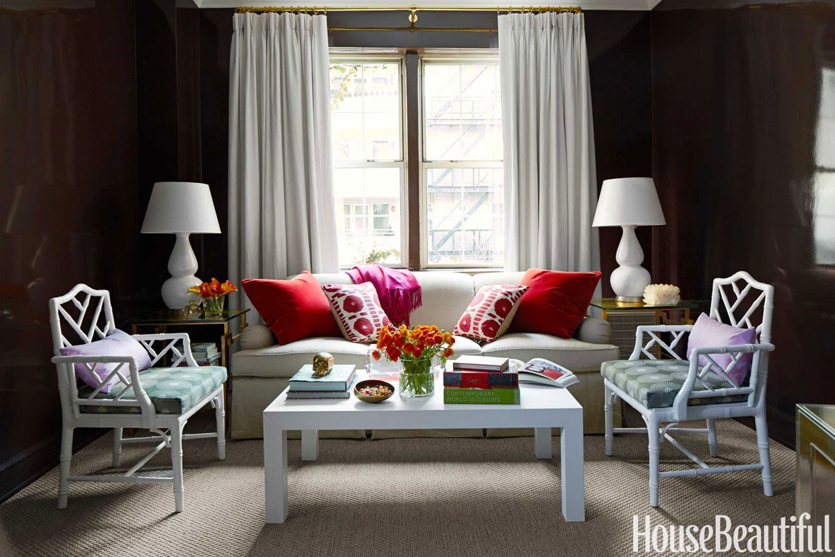 Attractive Bunn Offsets The Moody Walls With White Accents Like Floor To Ceiling  Drapes Hung By Brass Rods, A Sleek Parsons Coffee Table, And Jonathan Adler  ...
